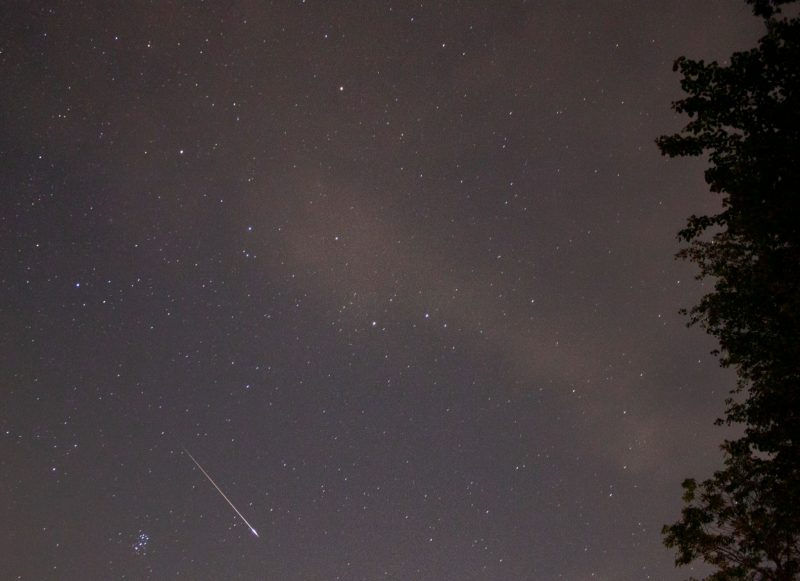 Meteor in lower left corner of image, with distinctly bright lower end of streak.