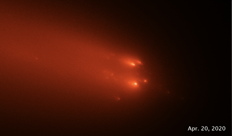 Comet Atlas: A black background with several bright orange blobs rushing through space with gaseous tails.