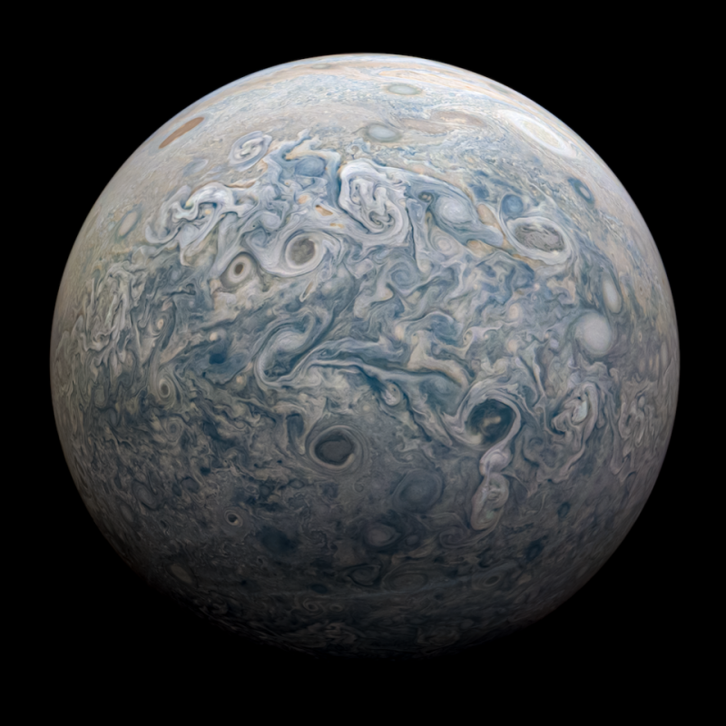 Large planet with many swirls and storms in its atmosphere.