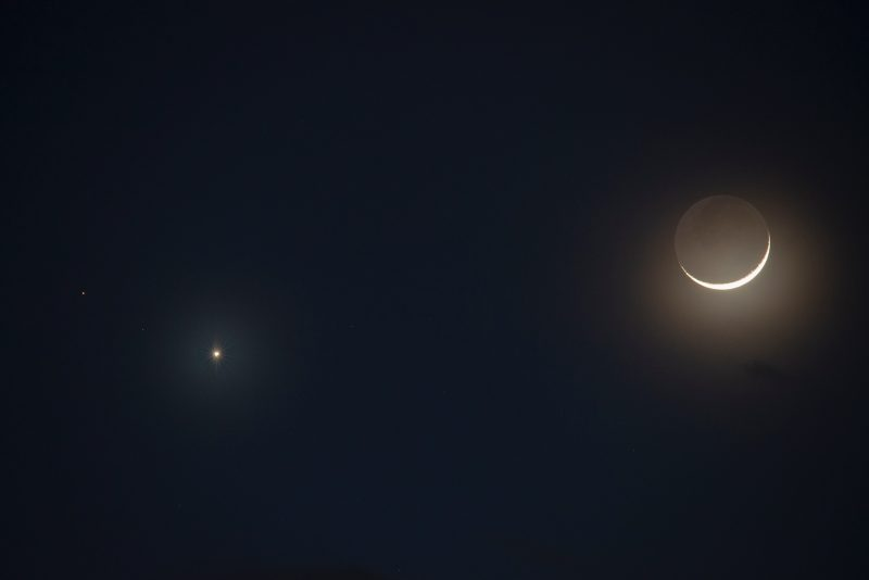 A bright dot, and a fainter one, next to a shining crescent.