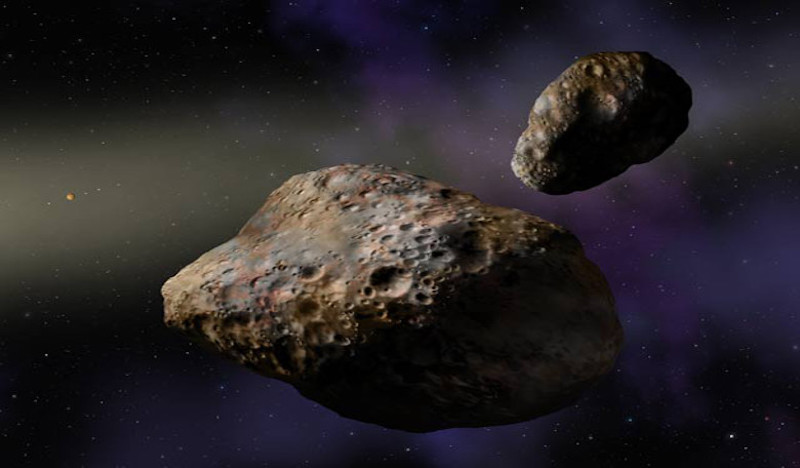 2 reddest asteroids in the main asteroid belt - potato shaped rocks floating in space.