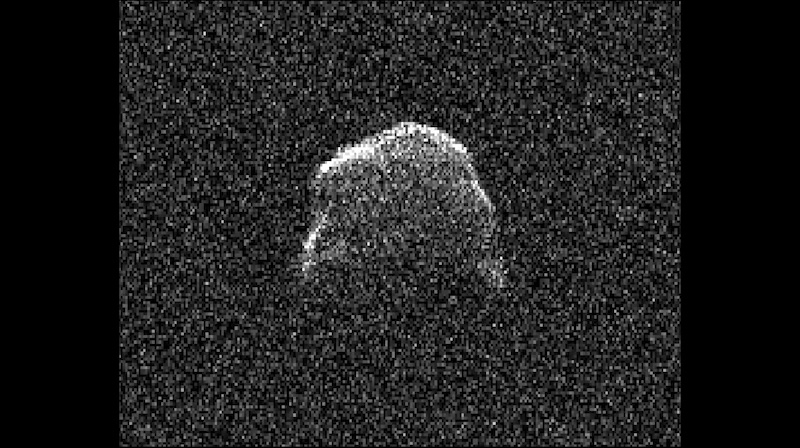 1,001st near-Earth asteroid: Irregular gray space rock on a black background.