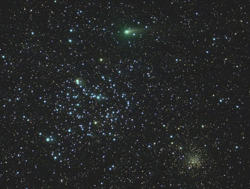 Dense star field with two distinct bunches of stars, and a small, elongated fuzzy green object.