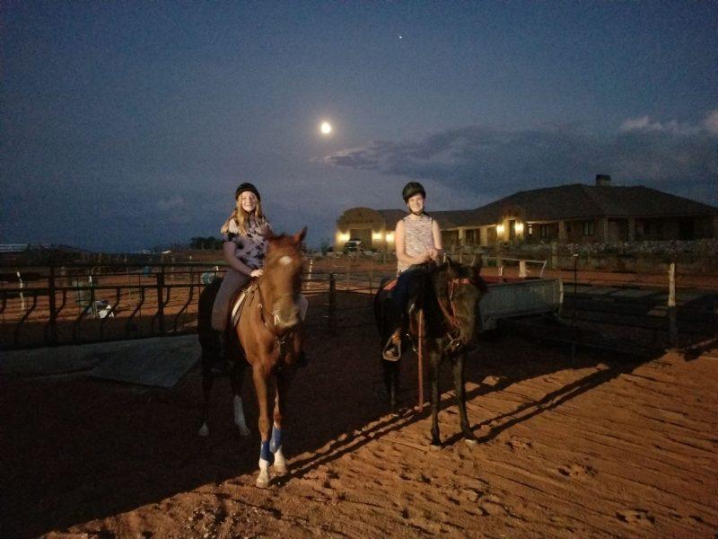 Horse riding in moonlight under the harvest full moon.