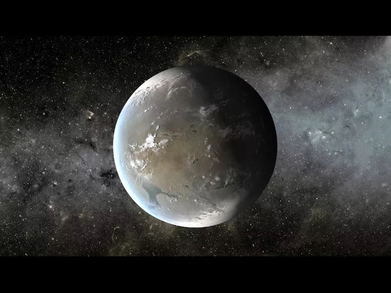 Large gray, rough-surfaced planet with seas and clouds against starry background.
