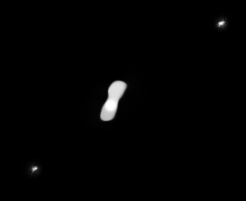 Dog-bone shape asteroid with two dot moons on either side.