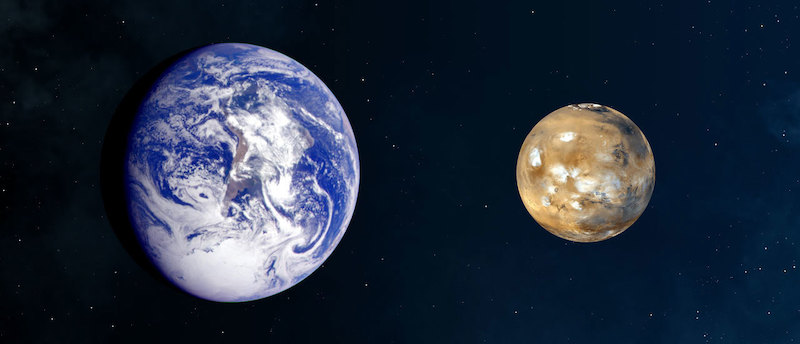 Space photos of Earth and Mars side by side, on black background, with Earth much bigger.