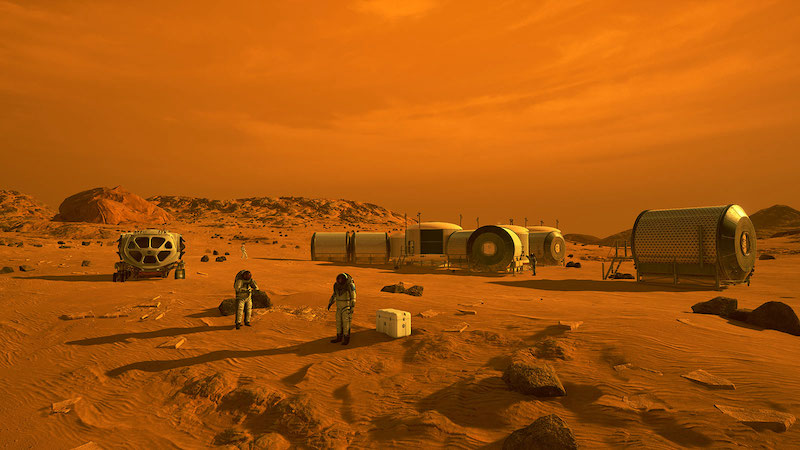 Astronauts, a rover and small cylindrical modular buildings on Mars.