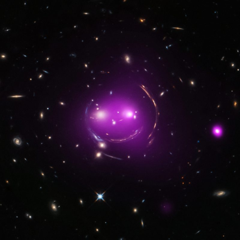 Purple glow resembling two bright eyes, small nose, curved mouth and side of head.