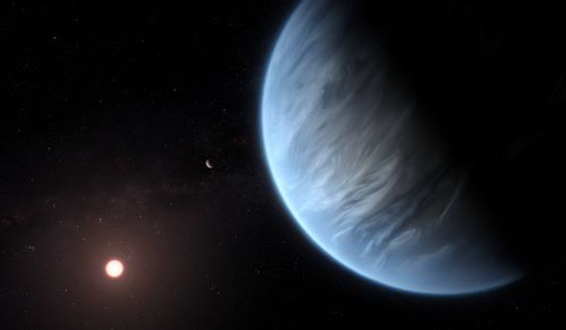 Where are the water worlds? Blue planet with cloud bands and sun in distance.