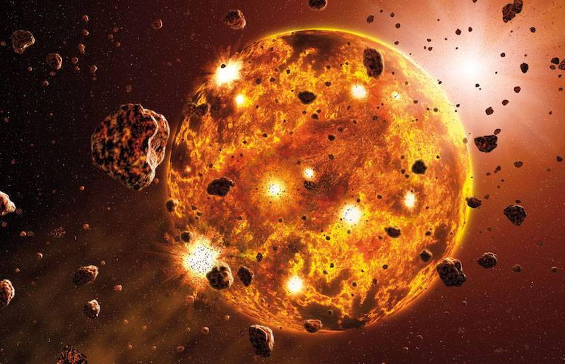 Large, spherical rocky mass with glowing impact explosions and many smaller space rocks around it.