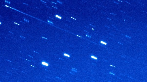 Comet or asteroid: Star field with short lines for stars, and a long streak that's the comet.