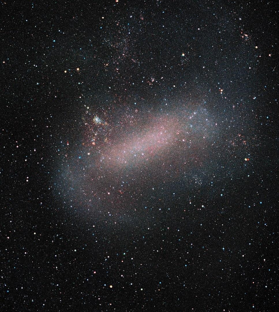 Pinkish blue haze around stars in an oblong shape.